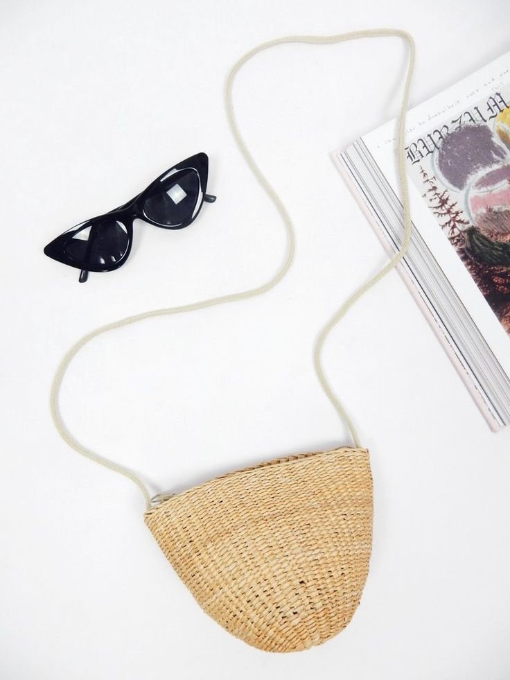 The Summer Dreams Woven Bag features a woven texture, zipper closure at top, and shoe lace shoulder strap.