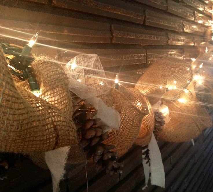 Burlap garland with lights.  DIY! It took me about an hour to make.  It's made from a string of lights folded four times into itself. Then I evenly wired the burlap onto my light string. Finished it off by adding white tule, ripped muslin and pine cones from the yard.