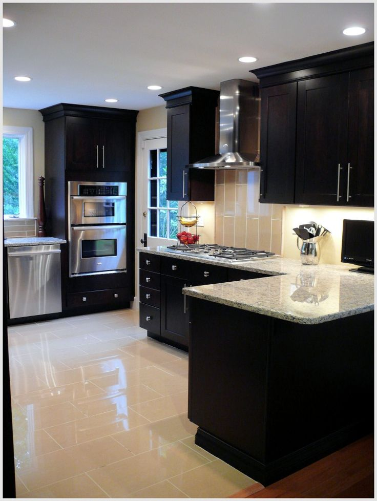 love the dark cabinets and light counter tops and floor, with stainless steel.