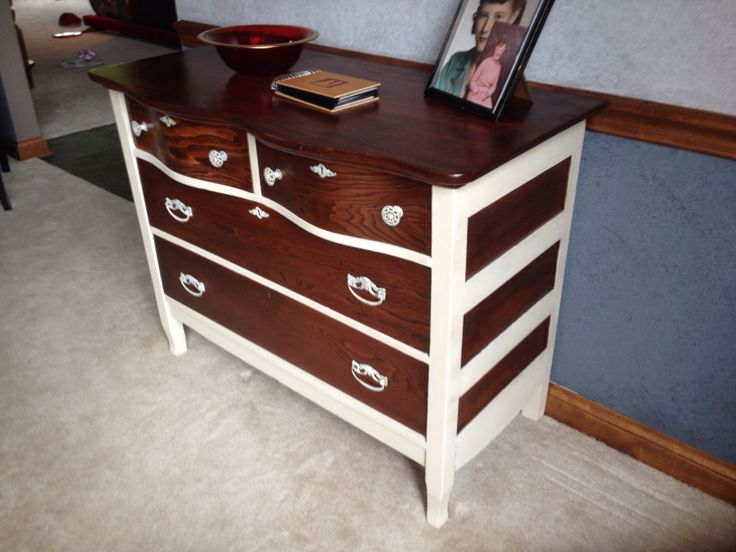 Refinished dresser.  Chalk paint by Annie Sloan (color: Old Ochre).  Drawers top and sides stripped and then stained with Minwax Red Mahogany stain.  Glossy clear coat finish.