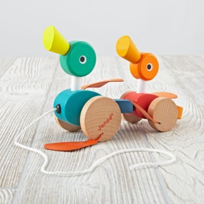Pull the string and watch the wooden duck family stroll forward.  They feature eye-catching colors and take a step in the right direction with each pull. Wooden pull toy features bright colorsShow 'em what you're made ofCherry wood and beechwood with non-toxic, water-based paintImitation leather for legsCare instructionsWipe cleanAge range1 and up.