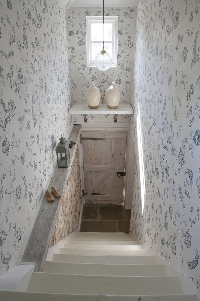 I like the painted white stairs and the door. Wall paper is too much .Nice blog with some really nice interiors