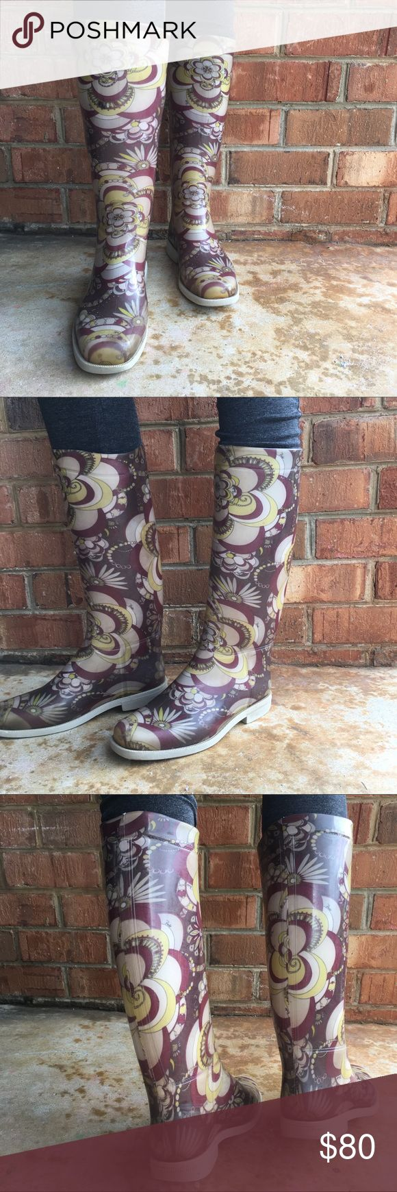 Emilio Pucci ☔️ boots designer rain boots made in Italy. Super comfy and slide on easily. Good vintage condition. Some scuffing and discoloration, but it is hard to notice because of the busy pattern. One inside sole liner is scrunching as pictured, but I don't notice it while wearing. Size 38. 15 inches tall. 14 inch calf opening. Emilio Pucci Shoes Winter & Rain Boots