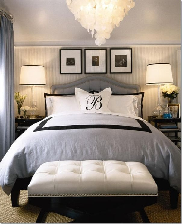 Black accents in the monogram pillow, hotel bedding with a black border, lampshade trim and picture frames add a touch of sophistication.