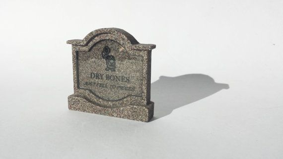 "This specific tombstones from the classic Mario Games, is Dry Bones.  Epitaph reads: ""Just fell to pieces"" Available at www.ChinookCrafts.Etsy.com"