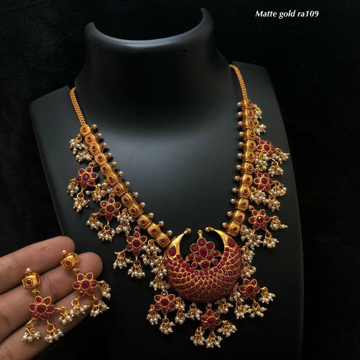 1590 . Beautiful one gram goldnecklace with chaandbali pendant. Necklace with rice pearl hangings. necklace studded with pink color stones. 01 January 2018