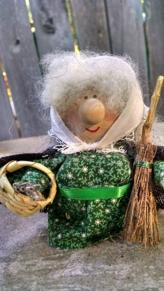 Here we have another kitchen witch constructed of wood and wool and standing about 4 inches tall. She wears a frock constructed from a vintage green