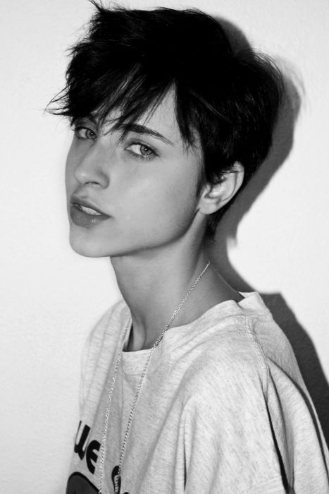 He is androgynous, androgyny is about being able to pull off looking like either sexes, and he does that very well.