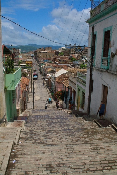 A steep street in Santiago, Cuba. Santiago de Cuba is the second largest city in Cuba. It is 540 miles south-east of Havana.