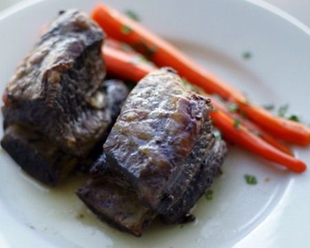 These short ribs are great with some glazed carrots or mashed potatoes. The best part is, you won't need much in the way of special equipment — just a food processor and a fat separator for skimming the fat off the sauce. You will have plenty of the flavorful beef stock left, which would be perfect for later use as a sauce. Or, freeze it until next time you cook your next short rib dish again.