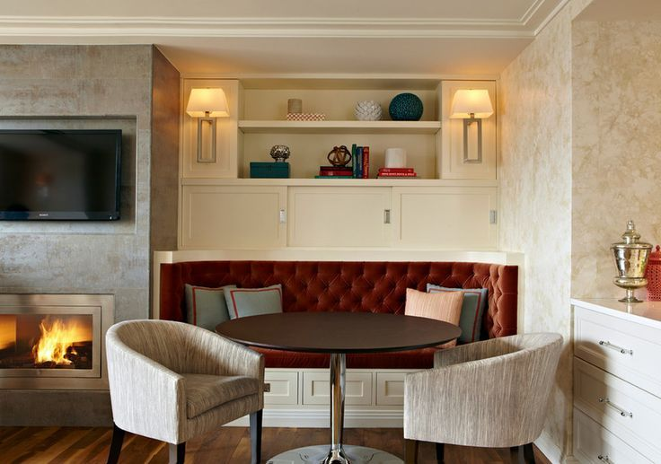 banquette flanking fireplace and TV; integrated into wall unit ...