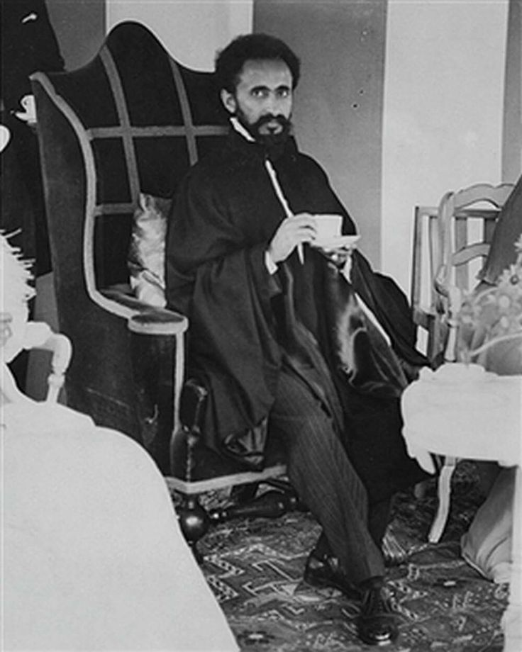 EMPEROR HAILE SELASSIE OF ETHIOPIA DRINKING A CUP OF TEA DURING A GARDEN PARTY AT LINCOLN HOUSE, PARKSIDE, LONDON, JUNE 8TH 1936.