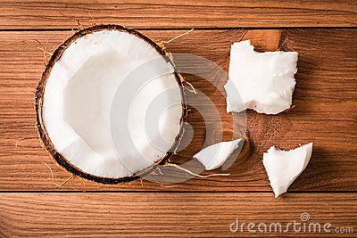 The pulp of coconut. Chopped Coconut. Wooden table. Top view