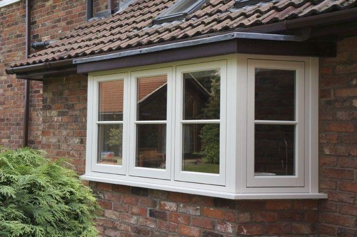 Timber flush casement bay window in Cream