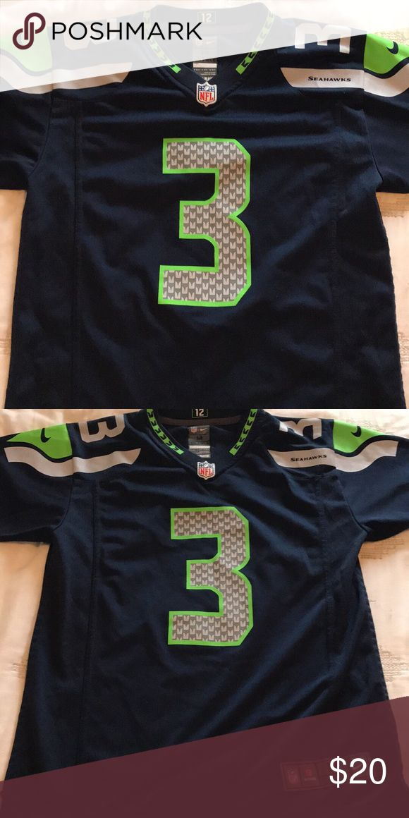 Nike NFL Seattle Seahawks Russel Wilson Jersey Authentic Nike NFL brand jersey for Russel Wilson of Seattle Seahawks. This is a kids size medium however it fits as a women's small. No signs of wear, only worn 5 or so times. Nike Shirts & Tops Tees - Short Sleeve