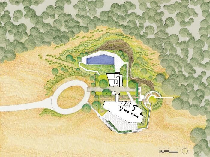 The landscape plan shows the house (white, at bottom center) nestled up near the massive rock ledges. Nelson Byrd Woltz (NBW) created low walls of concrete and stone that reach out like fingers to the hillside and woodland, defining terraces, a cutting garden and a pool.