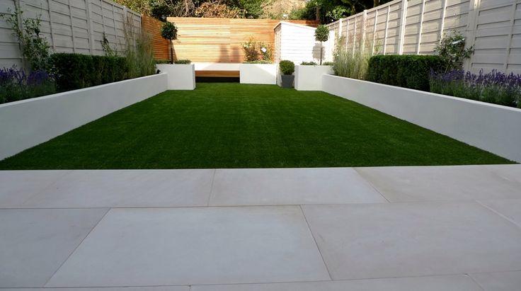 sawn sandstone paving easy grass raised beds hardwood screen and bench balham garden design london