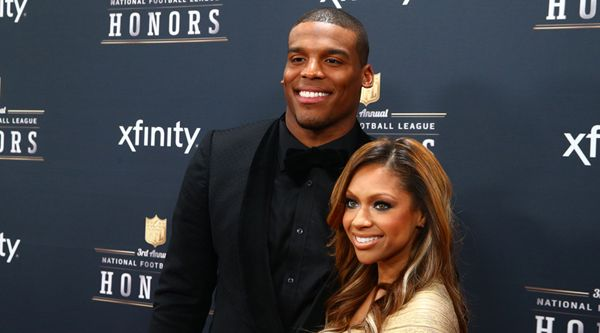 Feb 1, 2014; New York, NY, USA; Carolina Panthers quarterback Cam Newton (left) walks the red carpet with a female companion prior to the NFL Honors at Radio City Music Hall. Mandatory Credit: Mark J. Rebilas-USA TODAY Sports