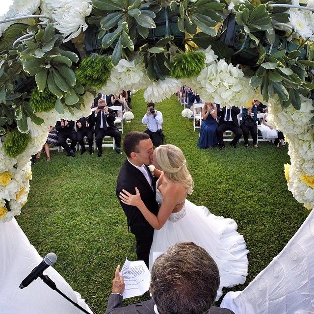 """You may now kiss the bride! Groom Brian Kamilar says of this special shot, """"My buddies hid a GoPro in the flowers of our wedding alter. We had no idea it was there, and before we got down the aisle they had posted it on online from their phone and tagged all our friends. Best day ever."""" #GoPro #Wedding #Love"""
