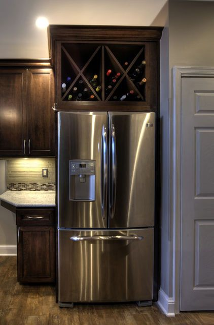 A Custom Wine Rack Above The Refrigerator Is A Spin Off On