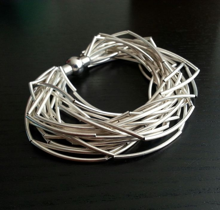 MiaQ | 11/2016 | Ringed Bracelet | Curved Silver Tubes