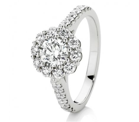 This engagement ring features 1.45ct of brilliant cut diamonds TDW, including a 0.70ct Canadian Fire centre stone surrounded by a flower cluster of diamonds and set in 18ct white gold