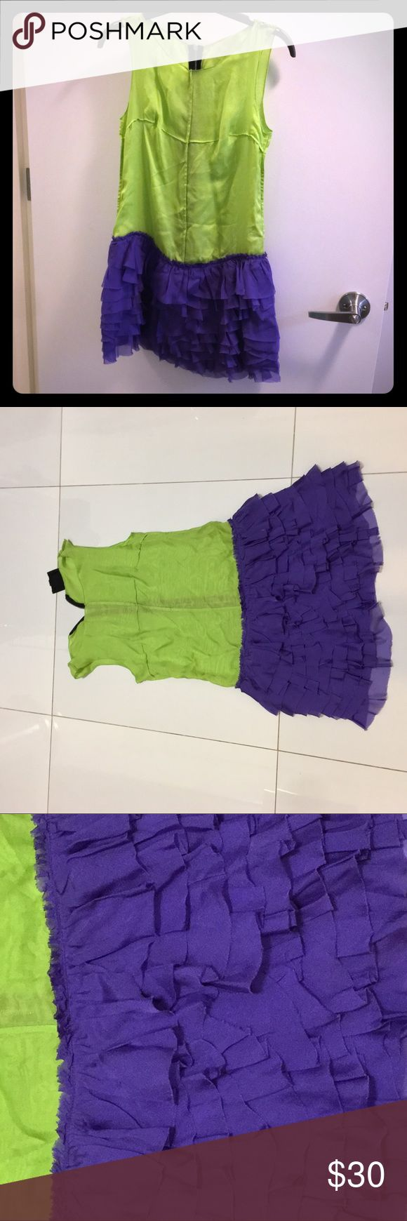 D&G Low-Rise Lime Green Mini Dress Lime green buttress + Purple cup cake ruffle skirt! This unusual color combination has also exposed stitches and zipper in the back.  Fun and easy to wear—perfect for the resort and a day to cruise around town! D&G Dresses Mini