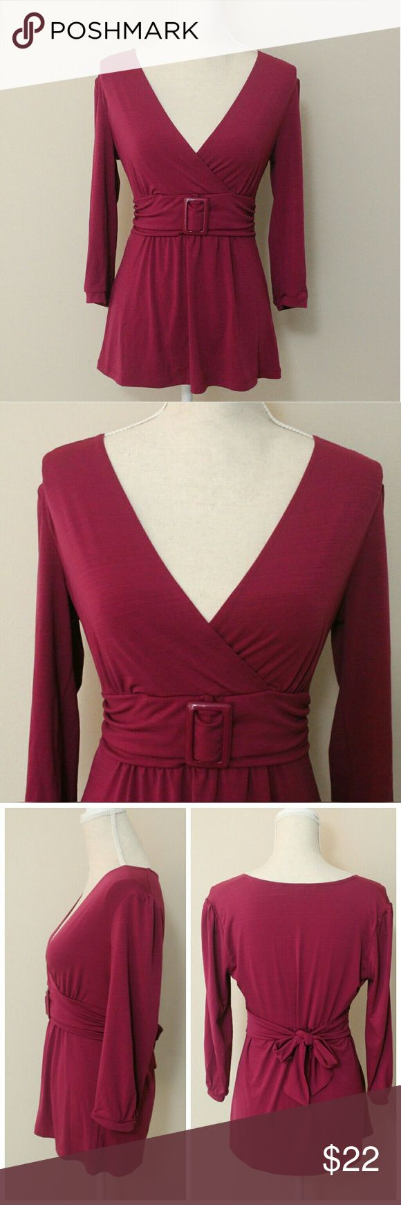 """Apt 9 Dressy Magenta Self Belt Tunic Top Size S NWOT Dressy Tunic Top with Self Belt and Bow Tie Back from Apt 9. Beautiful magenta color. Very flattering top. Looks amazing with leggings and so perfect for Fall. Thick stretchy material. 96% polyester, 4% spandex. 3/4 sleeve. Only tried it on once.   ℹ Chest 16"""" measured flat across pit to pit ℹ Sleeve 17.5""""  ℹ Length 25.5"""" from shoulder to hem  ℹ Fits great both Small and Medium Apt. 9 Tops Tunics"""