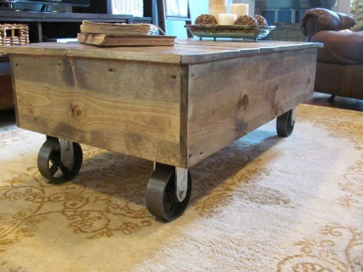 rectangle brown wooden coffee table with black metal wheels on beige carving rug rustic wooden coffee table with wheels to be placed in your dream living