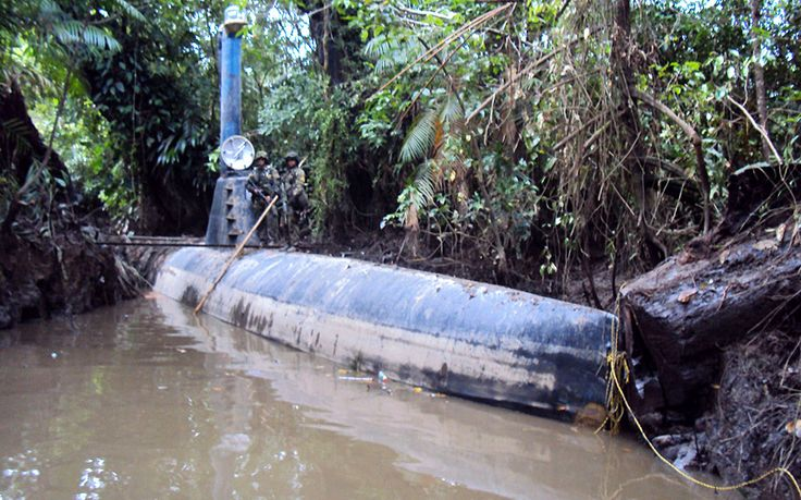 Colombian soldiers stand on top of a seized submarine built by drug smugglers in Timbiqui, Colombia in February 2011. Colombian authorities said the submersible craft was to be used to transport 8 tons of cocaine illegally into Mexico.