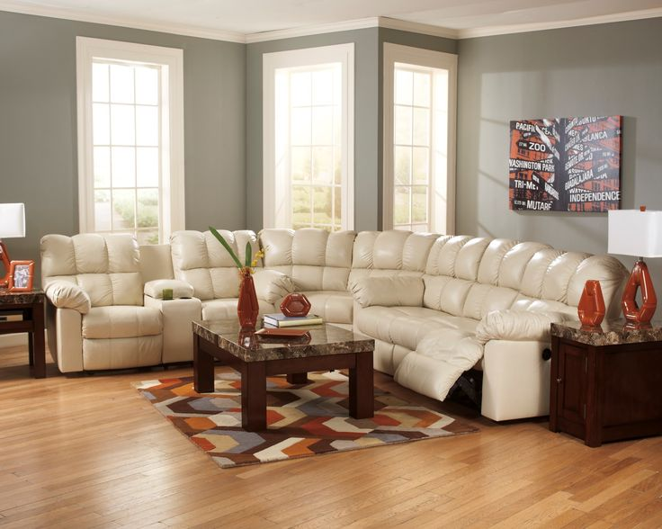 Sofa Slipcovers Beautify any living space with the Kennard Cream Sectional This luxurious sectional sofa es with