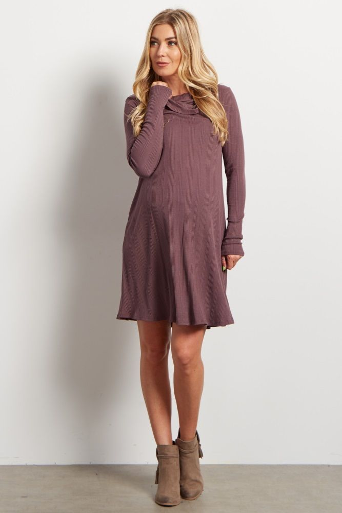 This trendy cowl neck long sleeve maternity dress has everything you want in a fall essential! With its soft ribbed material and solid hue, you'll want to reach for this dress throughout the seasons. Flattering and stylish, wear this dress with boots for a cute look.