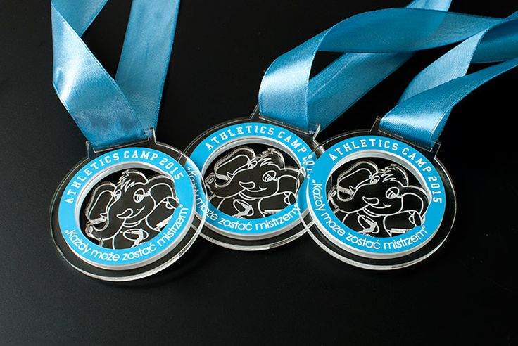 Medals, sport for children Medals with colorless plexiglass and blue laminate engraving .