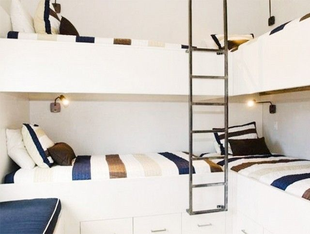 Modern, industrial, and graphic, this double bunk bed setup has timeless style.