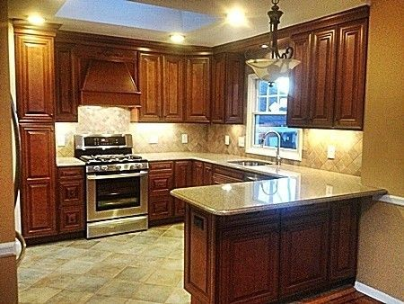 Remodeled Kitchen Complete With Tiled Floor And Backsplash Quartz Countertops And Stainless
