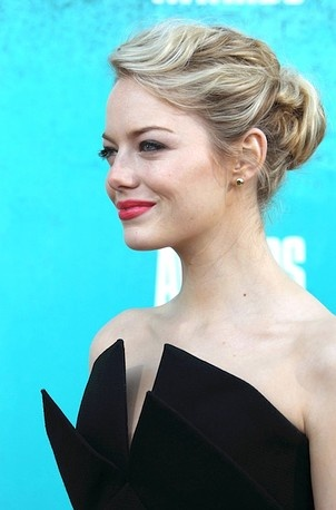 Emma Stone profiles her twisted bun.