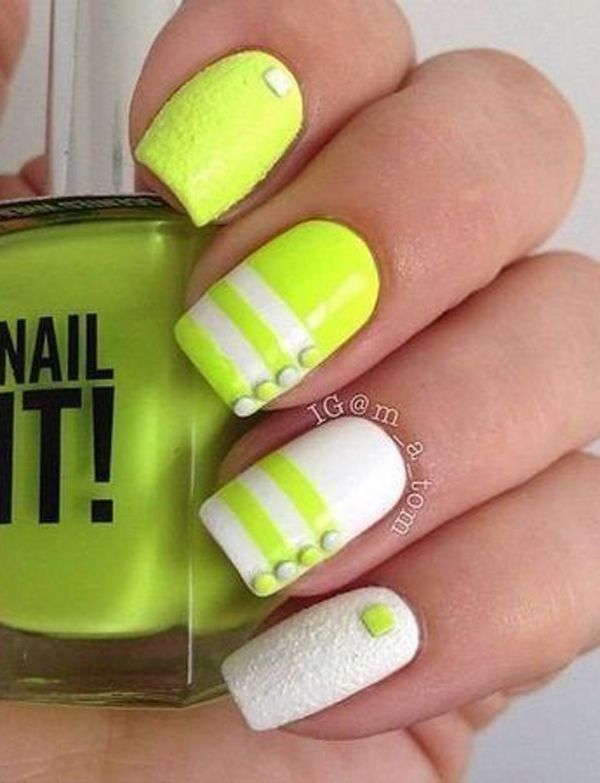 Simple yet pretty yellow nail art design. The nails are covered in yellow polish with white stripes near the tips as well as matte white polish and beads to complete the effects.