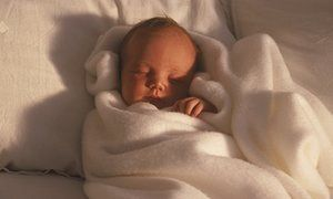Swaddling babies can cause them hip problems, doctors warn