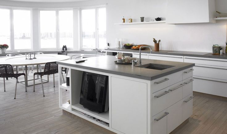 white cabinets with grey table tops and cool island