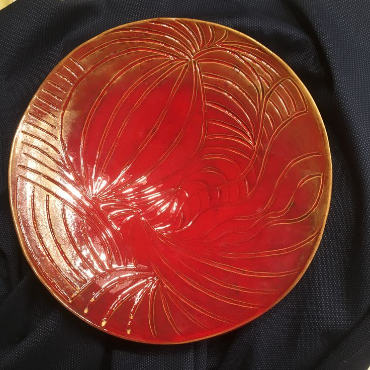 Big red glazed plate