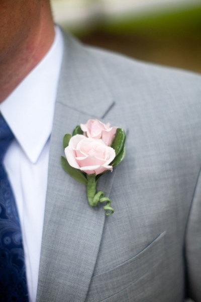 Pink boutonniere and light grey suit
