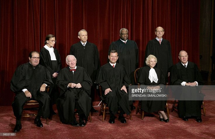 Justices of the US Supreme Court posing for their class photo 31 October, 2005 at the Supreme Court in Washington, DC. Seen in this image are: (First Row L-R) Justice Antonin Scalia, Justice John Paul Stevens, Chief Justice John G. Roberts, Justice Sandra Day O'Connor, Justice Anthony M. Kennedy, (Second Row-Standing L-R) Justice Ruth Bader Ginsburg, Justice David H. Souter, Justice Clarence Thomas and Justice Stephen G. Breyer. Earlier 31 October US President George W. Bush nominated judge…