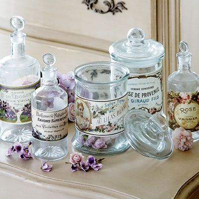 Gorgeous French glass jars decorated with pretty perfume labels reproduced from the 19th century.