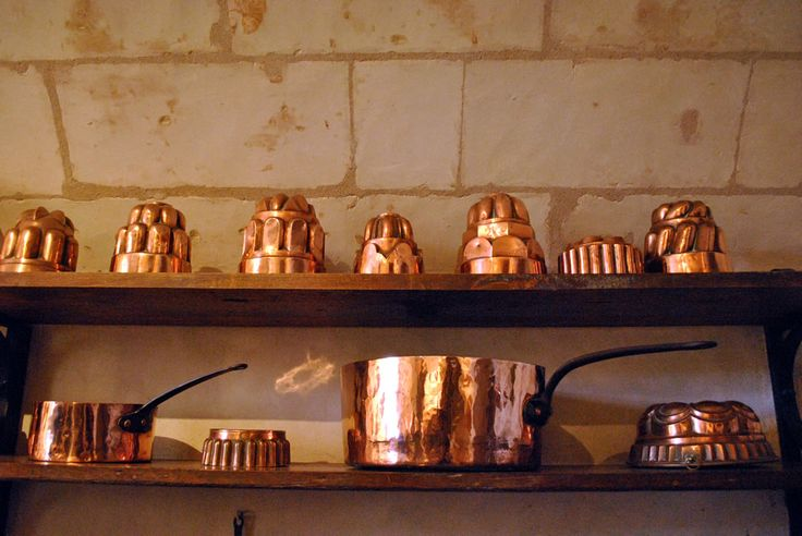Copper molds and pans in the kitchens at Chenonceau.  There was also a bakery area and a butchery room.  The kitchens are at the base of the castle.  From the windows you can see where provision laden barges were moored.