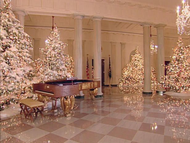 """White House Christmas 2004 The Grand Foyer was a sparkling forest of lights, featuring nearly 30 trees. Faux snow transformed the space into a winter wonderland that reflected the room's theme of """"I'm Dreaming of a White Christmas."""""""