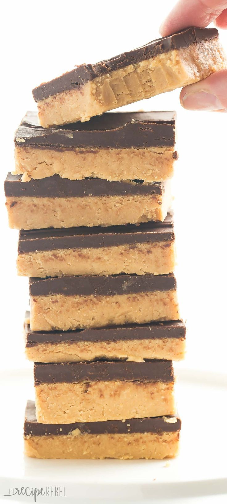 One ingredient makes these No Bake Chocolate Peanut Butter Bars BETTER than all the rest! They taste just like Reese's and are highly addictive! http://thereciperebel.com