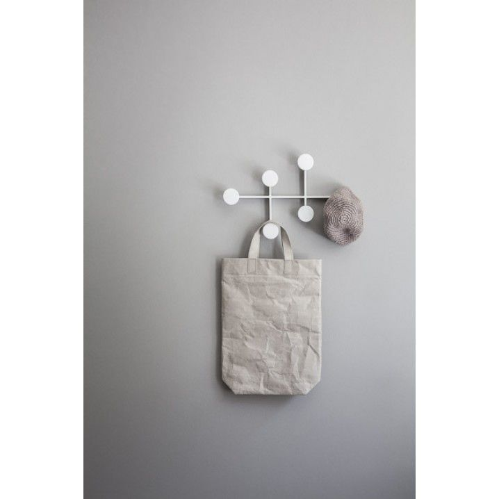 The designers behind Afteroom  and Menu are behind this  product inspired by the lightness and understatement of classic Scandinavian design. The Afteroom Coat Hanger is easy to mount – with the wall fixings hidden inside the frame.  Colour: White Material: Powder coated metal Size: H: 24 cm, W: 37 cm, D: 4 cm