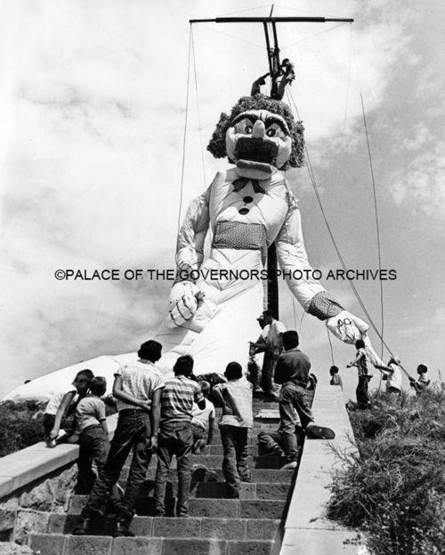 Children Watching The Construction of Zozobra (Old Man Gloom)  Santa Fe Fiesta, New Mexico, 1959  Photo By: Steve Northup  Palace of the Governor Archive#010909