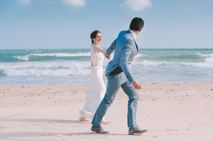Bride & Groom on Bournemouth Beach by Kevin Belson Photography. http://kevinbelson.com  Tel: 07582 139900 or 01793 513800 or email: info@kevinbelson.com