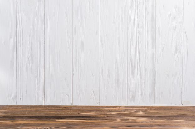 Download An Empty Wooden Desk Against White Painted Wall For Free Wooden Desk Wall Painting White Paints